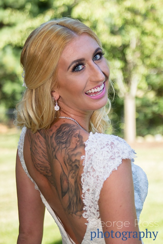 a smiling tattoo'd bride: rustic backyard wedding