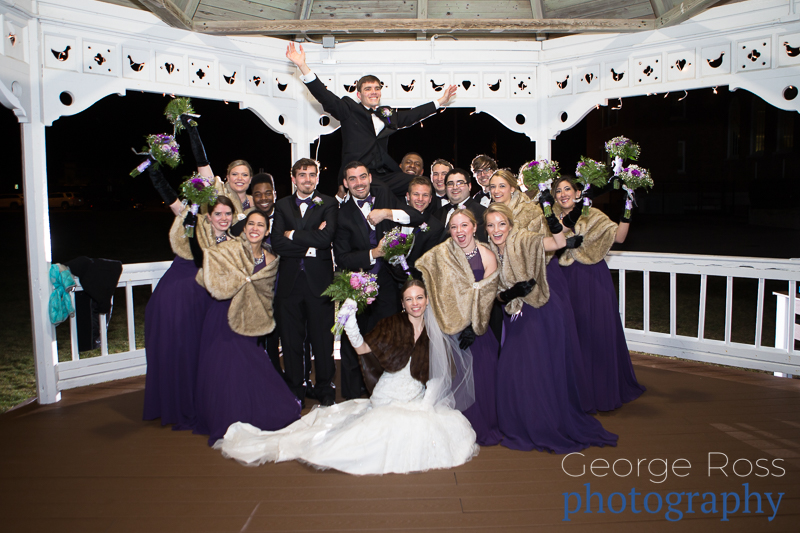 large bridal party in the gazebo at the narraganset towers at night