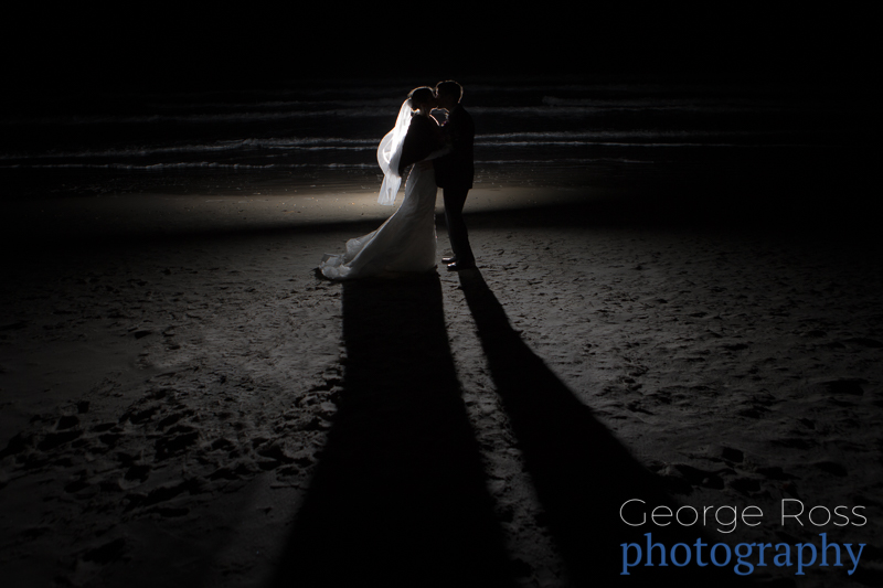 bride and groom on narraganset town beach at night