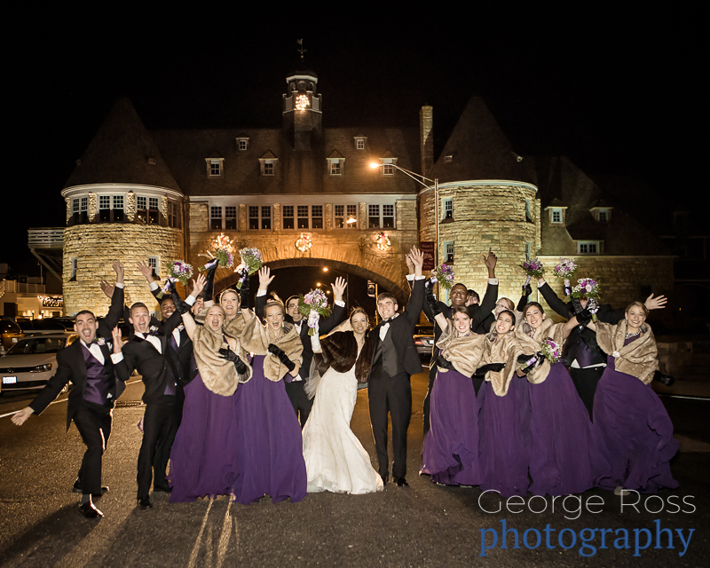 large bridal party in front of the narraganset towers at night
