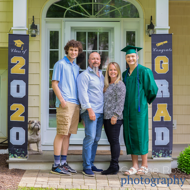 Covid-19 high school graduation with cap and gown and family, CHARIHO