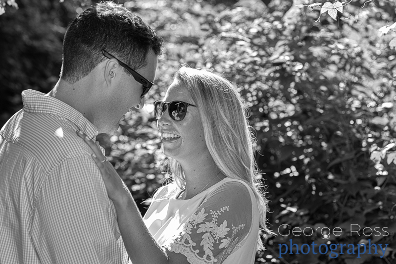 engagement photo shoot in roger williams park , providence, rhode islanda couple in a French kiss after their happy proposal photoshoot at castle hill, rhode island