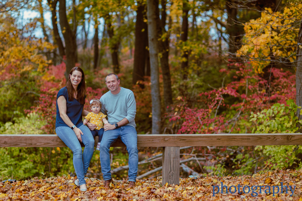 rhode island family photography: family with fall leaves as a background