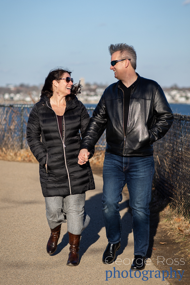 a happy couple after a proposal on Cliff Walk, Newport