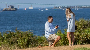 man kneeling to propose at the castle hill inn, newport, rhode island