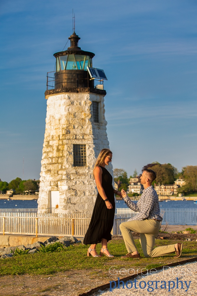 man kneeling to propose in front of the goat island lighthouse