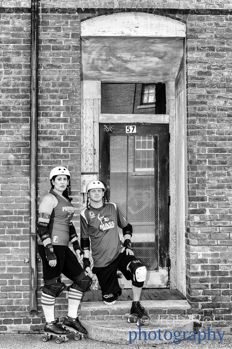 a roller derby couple in a doorway