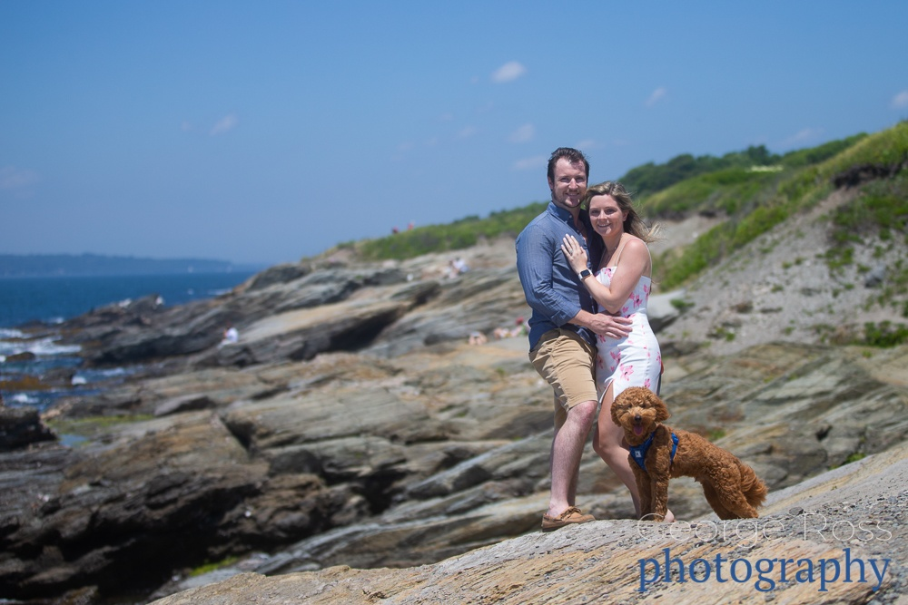 a couple celebrating after getting engaged in beavertail State park, rhode island
