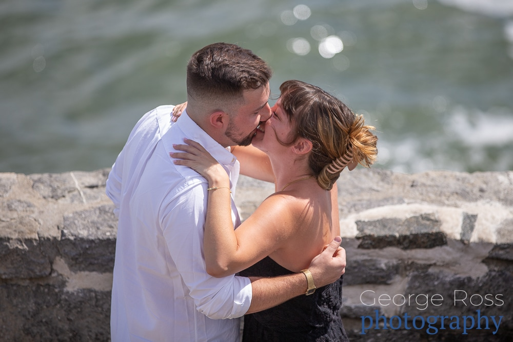 A couple's surprise proposal on newport, rhode island's cliff walk at the 40-steps